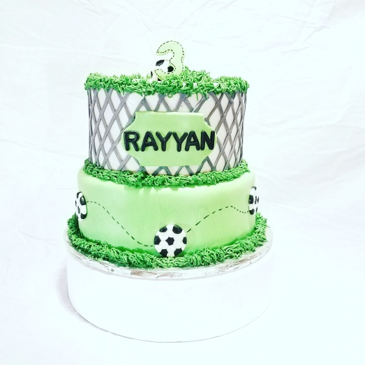 Soccer themed cake (fondant) - Vanilla with raspberry mousse filling and chocolate with coconut filling